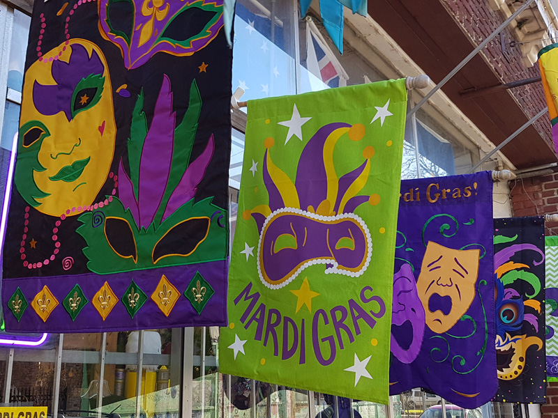 In preparation for Mobile's Mardi Gras, Dauphin Street is brightly decorated with banners and flags to get everyone excited about the event.