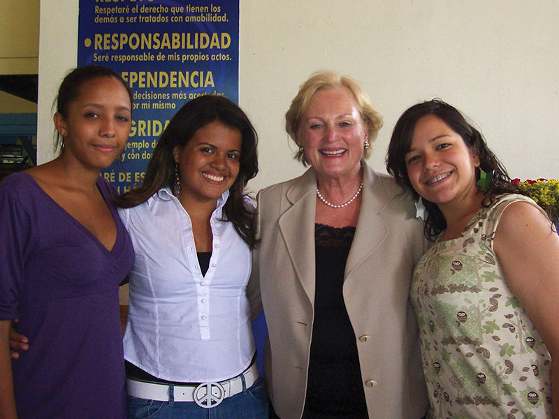 Christel DeHaan is pictured with three graduates from one of the charity's schools. There are as many as 4,000 children in the schools at one time and the graduation rates are exceptionally high, with many CH graduates going out into the world and taking up professions and good careers.