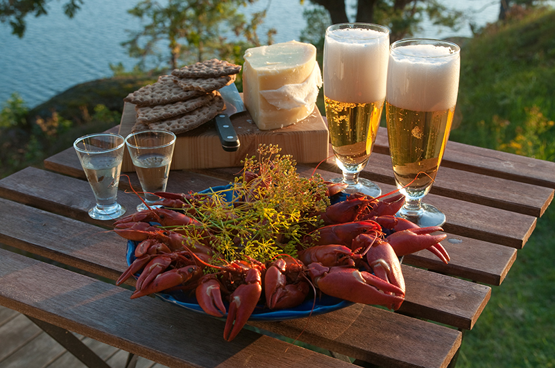 Summer crayfish parties are the place to be. Lakeside in the warm sun, with crayfish, bread and cheese to eat, washed down with beer and schnapps, is delightful.