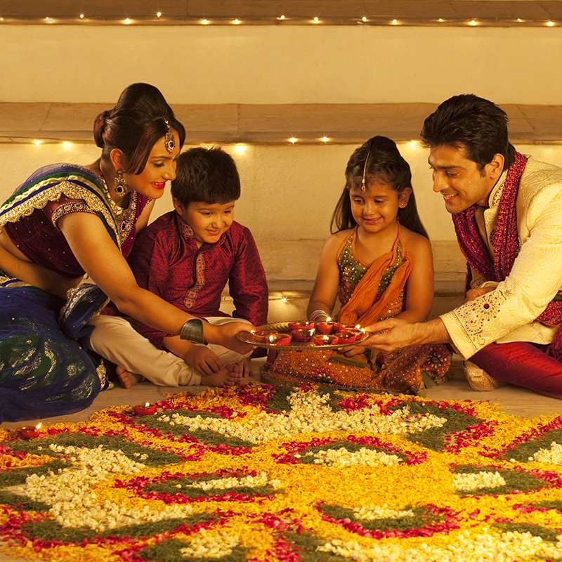 Pretty Rangoli designs are made using coloured powders, rice and flower petals and are thought to bring luck.