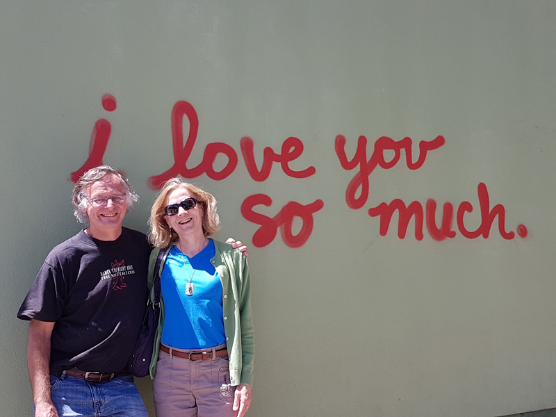 Donna and her husband pose under one of many iconic landmark wall murals in Austin, Texas, which is something of an art capital in the US.