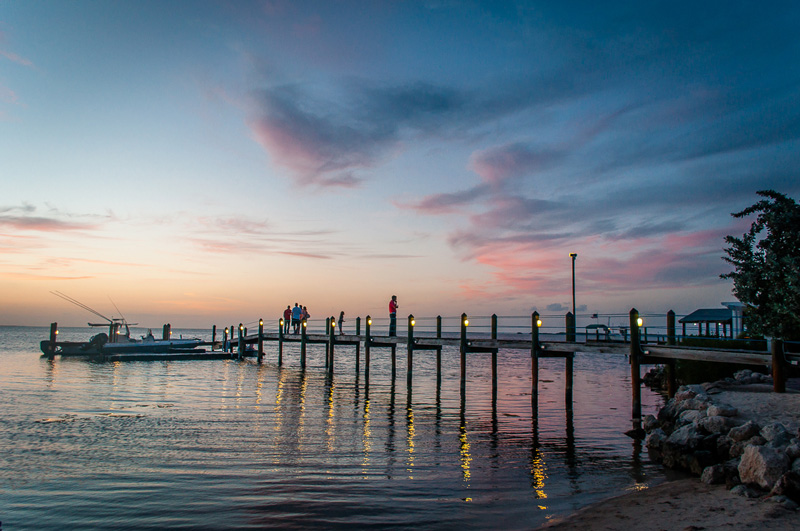 Sunsets are second to none in the Florida Keys, Best experienced over a delicious meal in a seaside restaurant with views across the water.