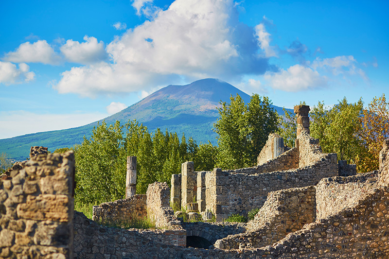 The ancient Roman city of Pompeii is a must visit for a glimpse into the past. With the imposing Mount Vesuvius looming over this preserved historical site, a trip to Pompeii is a sobering reminder of the power of nature and times gone by.