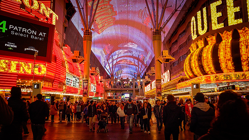 Experience the bright lights and glamour of the Fremont Street Experience in Glitter Gulch.