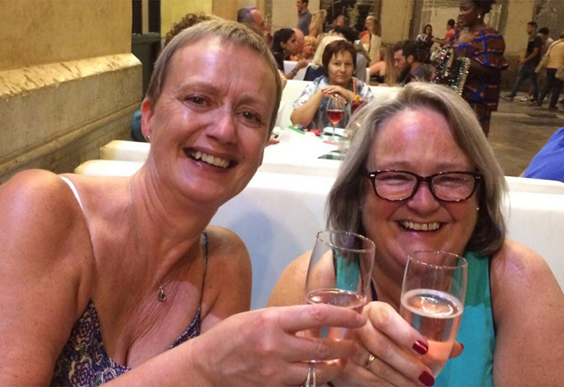 Susan and her friend, Kim, enjoy a drink in the sun on one of their RCI Exchange Holidays together which Susan was able to secure by using the trading power allocated to her owned timeshare weeks, as well as by taking advantage of some of the great-value RCI cash only holidays, to get extra holidays to share with her friends.