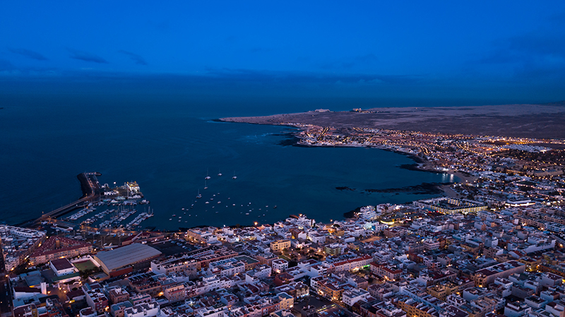 Aerial view of the Corralejo coastline at night.