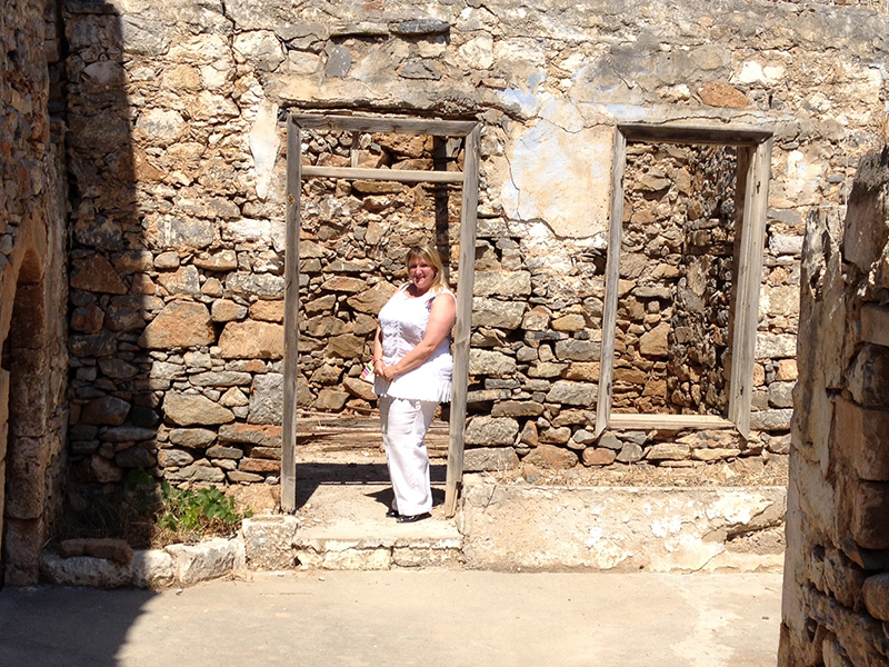 Here I am on a real mission, exploring the ruins of former leper colony on Spinalonga island, off Elounda in Crete. Since reading Victoria Hislop's  historic novel, The Island, based on the experiences of the lepers who were exiled to Spinalonga I had wanted to see these buildings for myself.