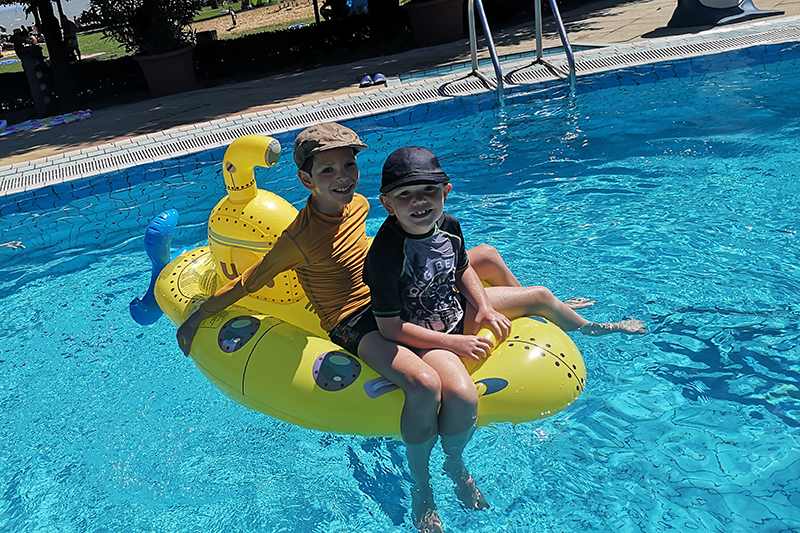 The lovely swimming pool at Varosi Strand was a big draw for the boys, especially as they were permitted to take their favourite pool toys in with them!