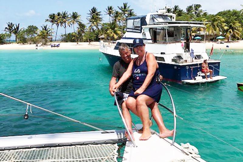 Janine and John on board a TradeWinds' catamaran in the Grenadines.