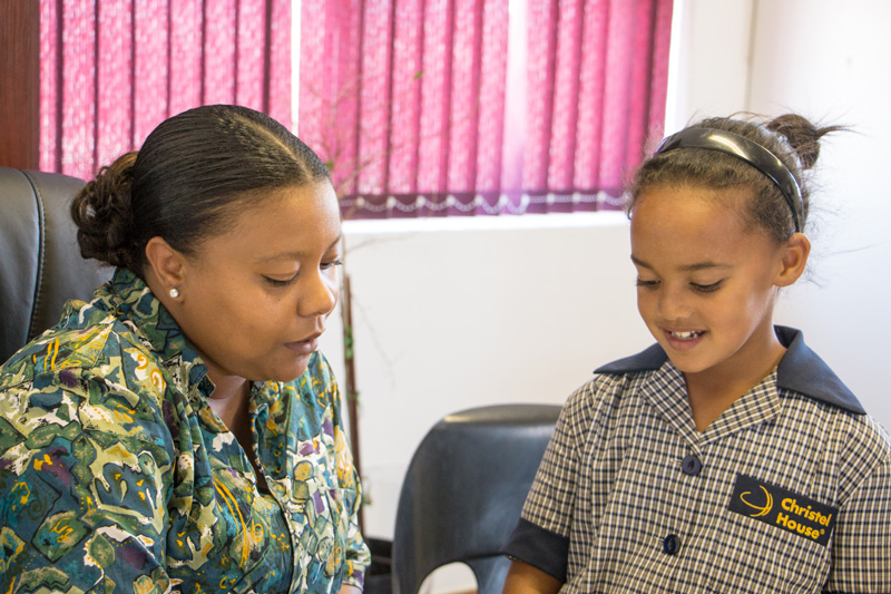 Kristen helps a Grade 1 student at Christel House South Africa. Christel Huose needs your support. Please donate to help children like Kristen to make smething of themselves and to have a future worth living.