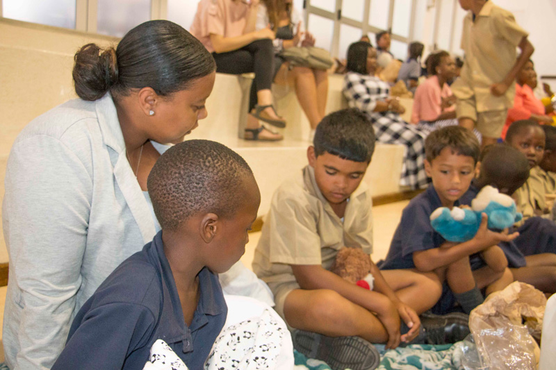 Christel House South Africa graduate, Kristen Matthews, assists with the children during World Read Aloud day.