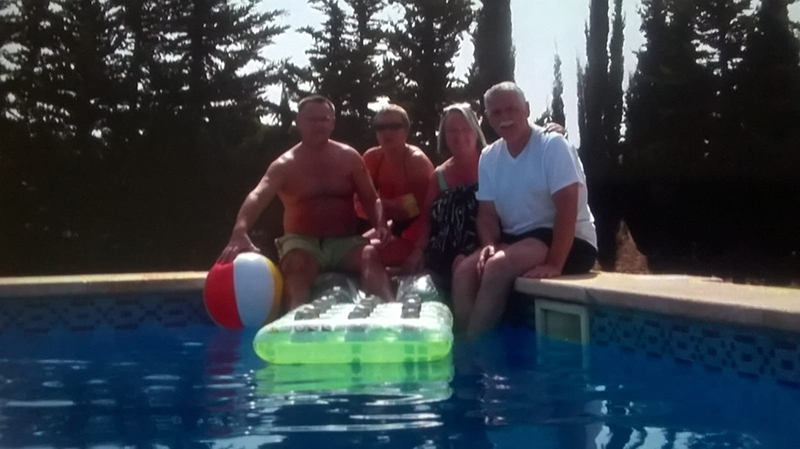 Round the pool again - this time 40 years on, and the four friends are still having fun together on holiday.