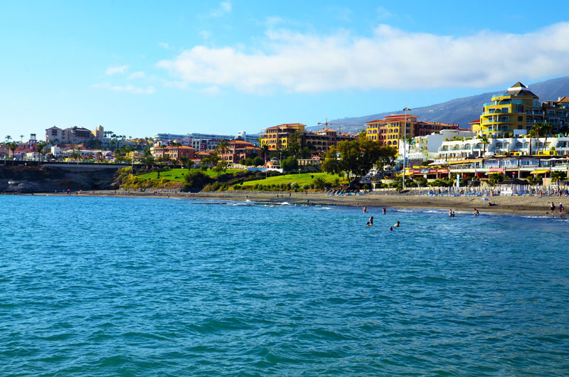The warm shallow waters of Playa de Fañabé are ideal for the children to splash about in