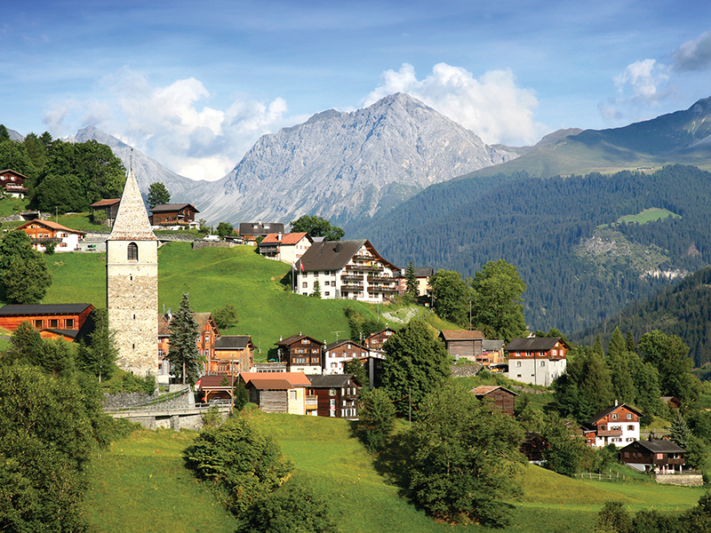 I, for one, am more accustomed to meandering around Mediterranean villages with their sunny pan tile roofs. Looking at this picture of a picture-perfect Swiss village, I wonder why I haven't wandered further afield to different regions.