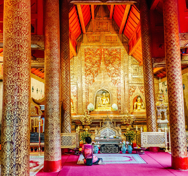 The vivid colours of Wat Phra Singh, one of the Chaing Mai's most revered temples, is a magnificent complex .