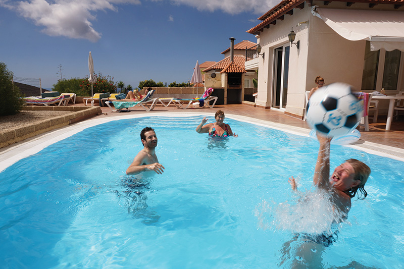 The Bushell family enjoying some fun time in the pool on an RCI Exchange Holiday. Tracie is careful to combine any weeks and credits she has left to book more time away on holiday, making sure that nothing is wasted.