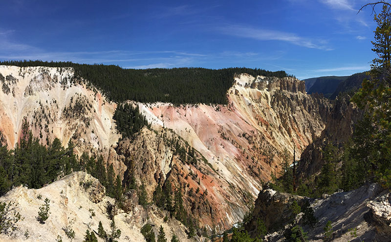 Yellowstone National Park gets its name from the colour of the dramatic rock and canyons that have splintered apart, leaving beautiful hiking trails behind.