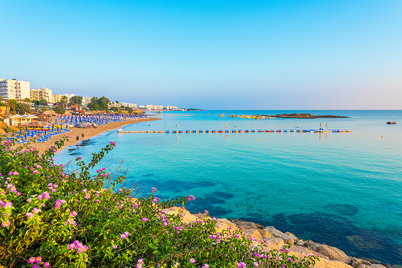 Fig Tree Bay is one of Cyprus' prettiest beaches. Shallow and sheltered thanks to the uninhabited islet which can be easily accessed by swimming over, it's great for families.