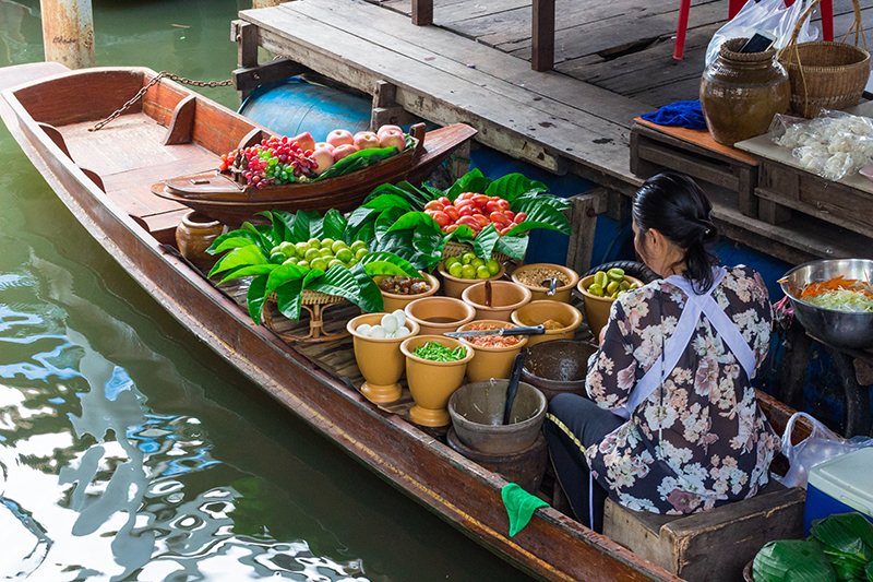 The Taling Chan Floating Market is one of the most unique places to visit in Thailand. Locals sell their wares from boats on the canal and you can get everything from flowers to fresh fish there.