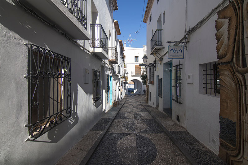 The narrow winding streets in the towns and villages in hot destinations have been specifically designed to keep the houses and shops cool by keeping them in the shade.