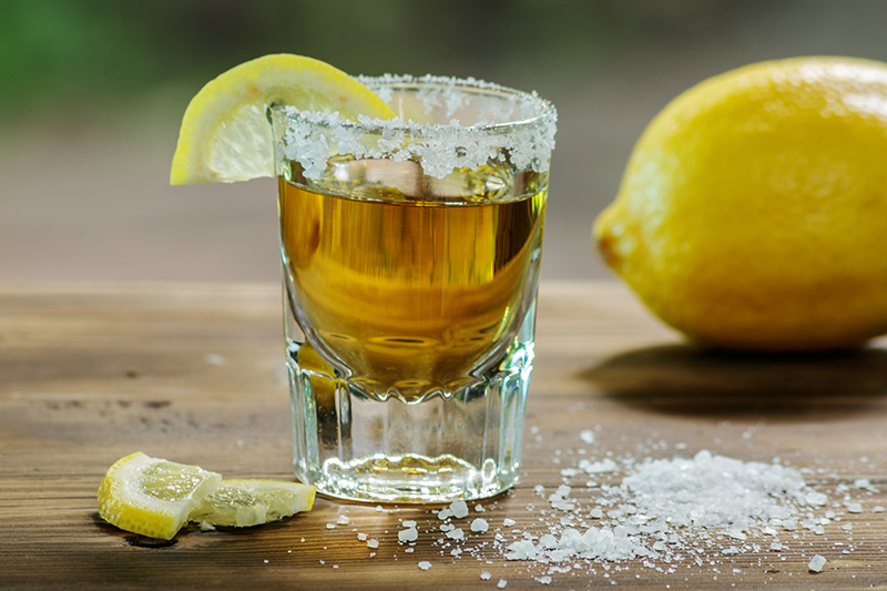 Many people have experiences of tequila shots, which are preceded by a lick of salt and followed by sucking a slice of lemon and lime - an acquired taste, but a must-try in Mexico.