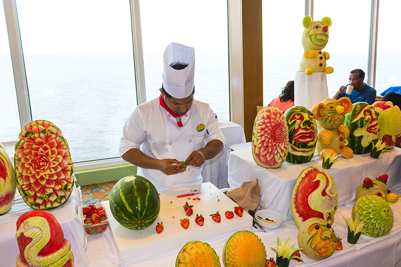 The choice of food onboard is endless! Here, a chef showcases his skills for cruise passengers in an amazing culinary exhibition.