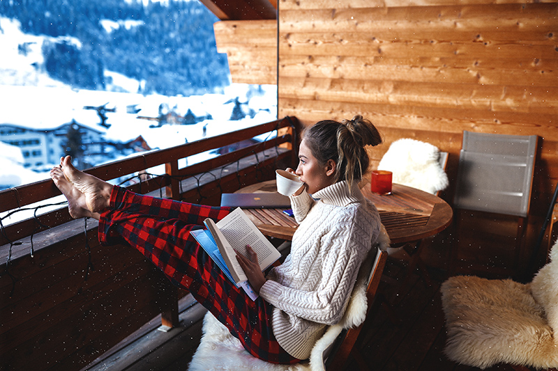 Picture this: snow falling outside after a long day of flying down the slopes. The perfect way of winding down after a busy day is with a good book and cup of tea on your resort balcony. Bliss.