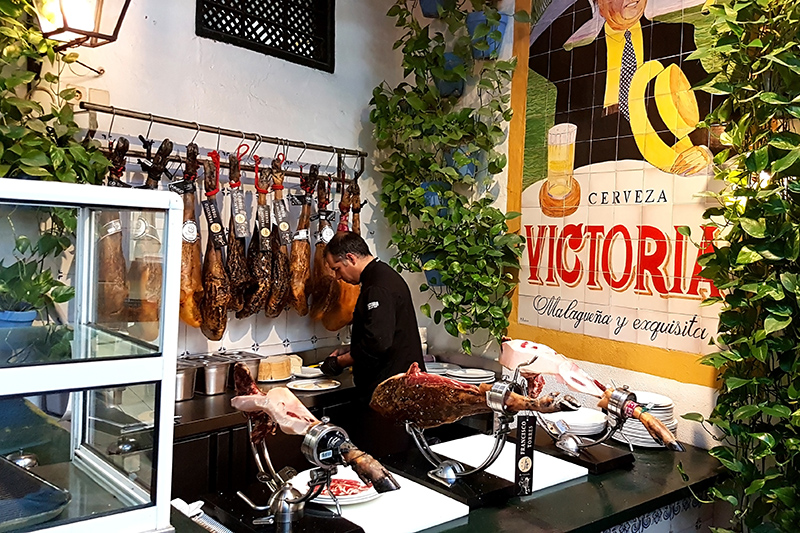 The process of cutting the delicious spanish jamon serrano in the restaurant bodega El Pimpi, Malaga, Spain. This place is well-worth a visit to try some of the local dishes.