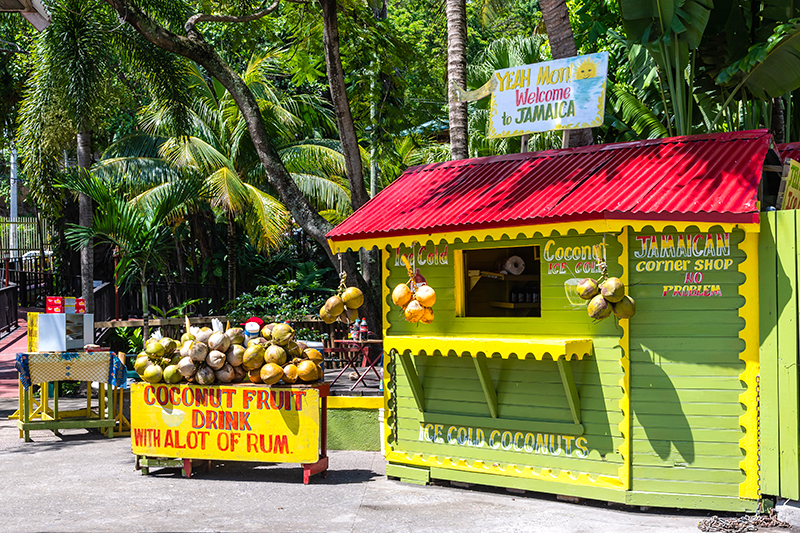 A Caribbean-colourful ice-cold coconut fruit drink and rum stall is a familiar sight on many of Jamaica's beaches, so you are never far away from a cooling drink on these hot sands.
