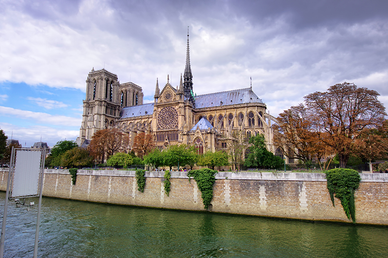 An illustrious medieval cathedral, Notre-Dame de Paris translates to 'Our Lady of Paris' and is revered across the globe. This photograph was captured before a terrible fire raged through the cathedral in April of 2019, devastatingly destroying the spire and parts of the roof.