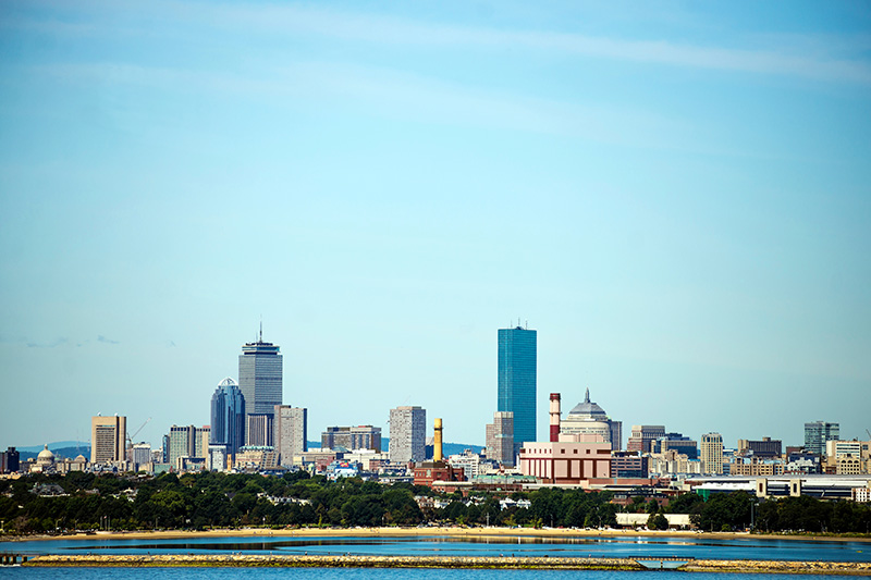 City skyline of Boston, fronted by Southie in the foreground.