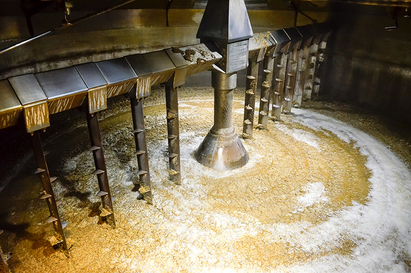 A traditional mash tun used in the distillery of malt whisky. This machine uses a process of very hot water and 'agitation' to remove sugar as part of the distilling process.