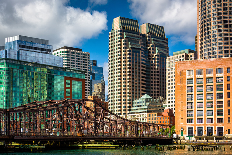 Where old meets newer. An old bridge over the Fort Point Channel in the Historic District of Boston contrasts with the newer high-rise buildings.