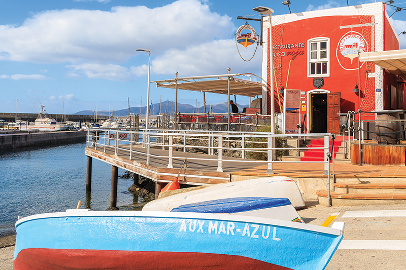 A colourful harbourside restaurant nestled on the shore of Puerto del Carmen, Lanzarote, would be the ideal stop off for dinner before the dancing commences..