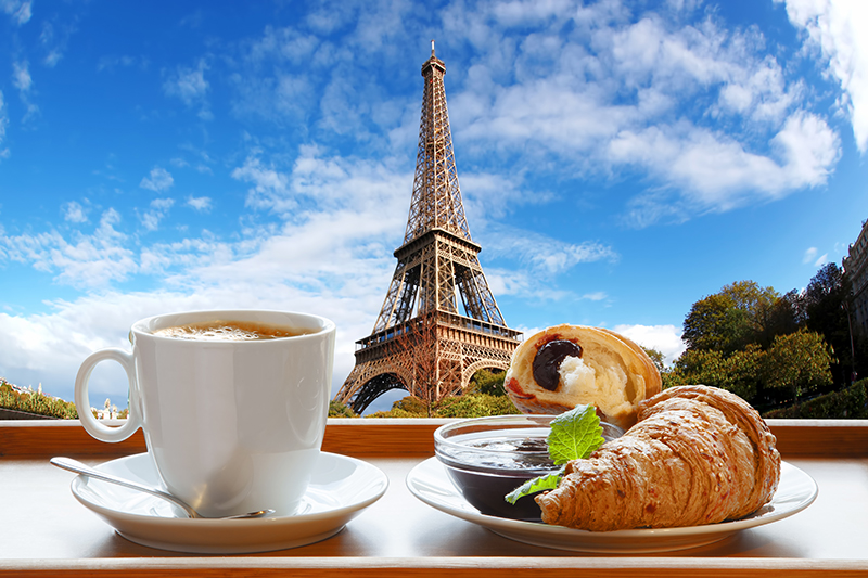 Start your morning in true Parisian style with a coffee and buttery croissant from a local bakery or 'boulangerie.'