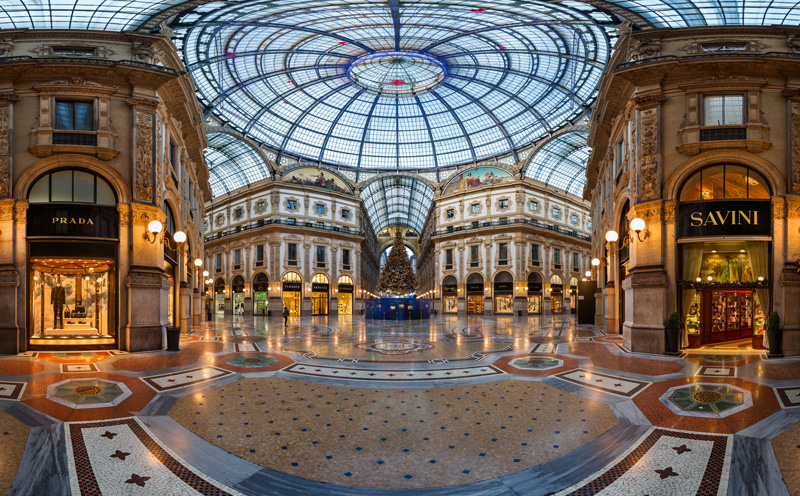 The glass roofs of Galleria Vittorio Emanuele II come together at the base of its impressive glass dome, bathing the glittering shops below in light.