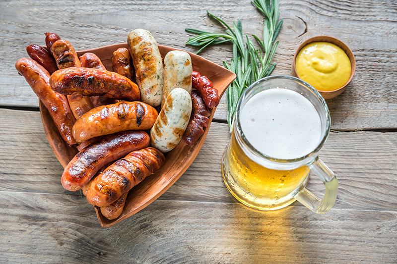 Savour the flavour and enjoy the traditional German snack of bratwurst, a tasty sausage, complemented by a jug of weissbier (German wheat beer.)