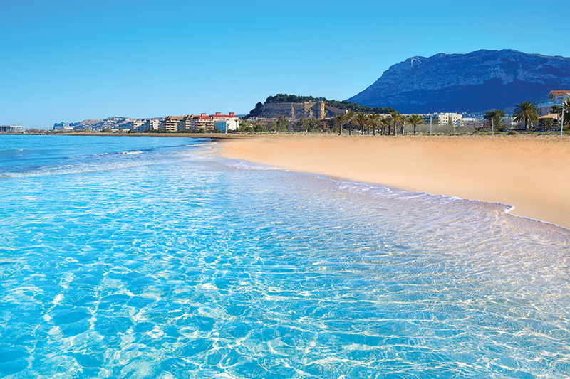 Golden sands and crystal waters of Dénia Beach.