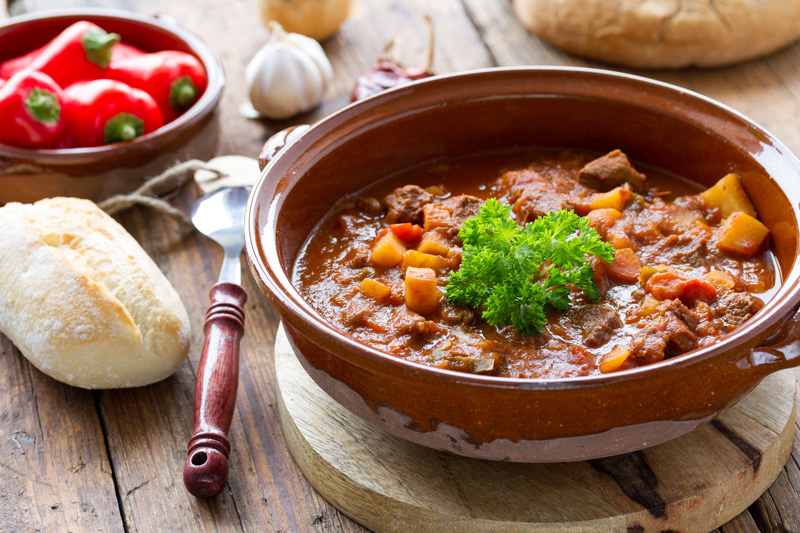 One of Hungary's most famous food exports is, of course, goulash. The famous dish is best eaten with a glass of Hungarian wine - ask the locals for recommendations and enjoy a delicious meal.