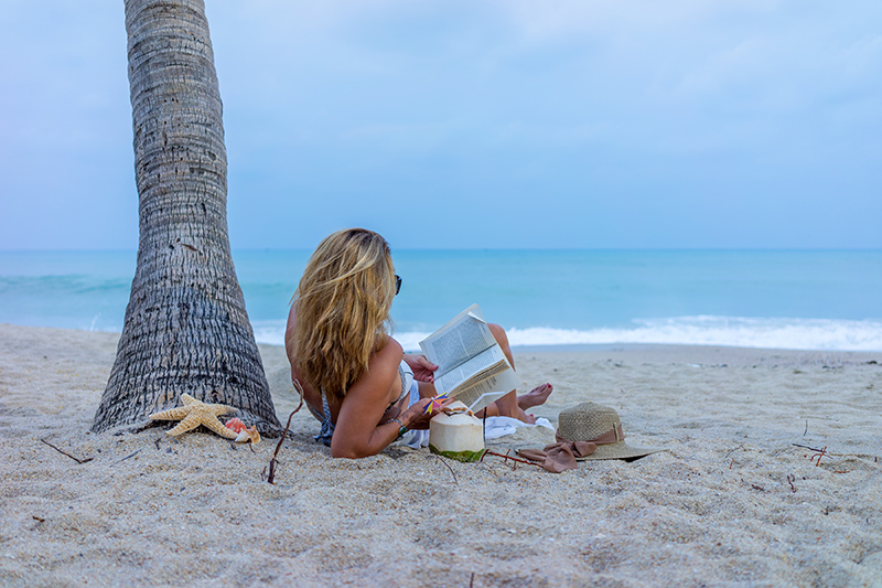 A sandy beach, a cocktail in hand and a good book, what more could you want? You just have to decide whether you want a good mystery, a crime drama, or a soppy romance to get lost in.