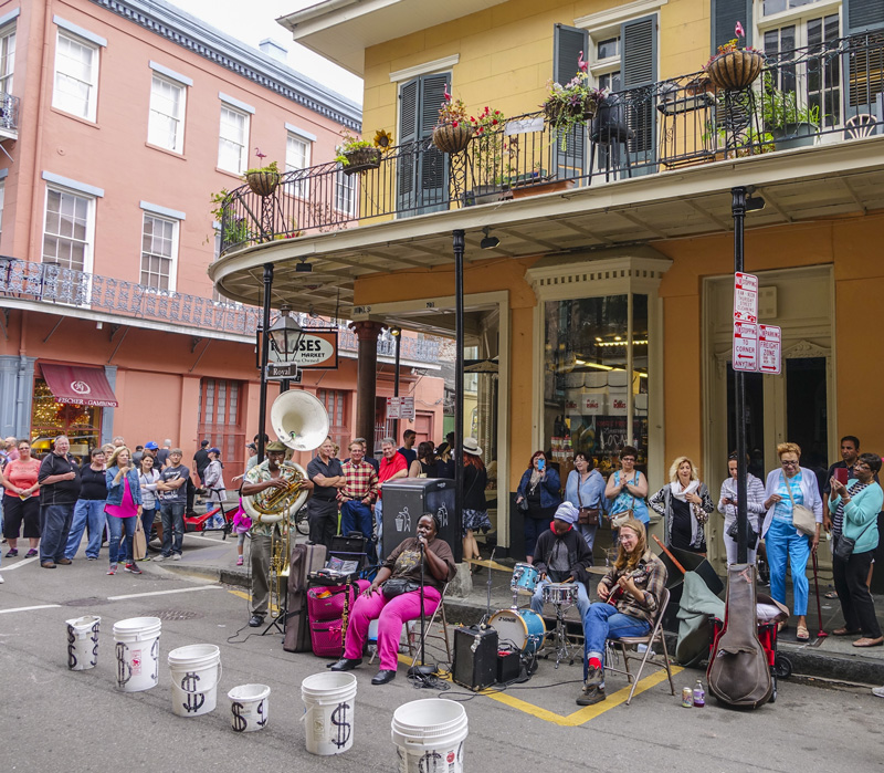 Buskers on the streets of New Orleans entertain locals and holidaymakers. It is party time, all the time, down Bourbon Street in the French Quarter.