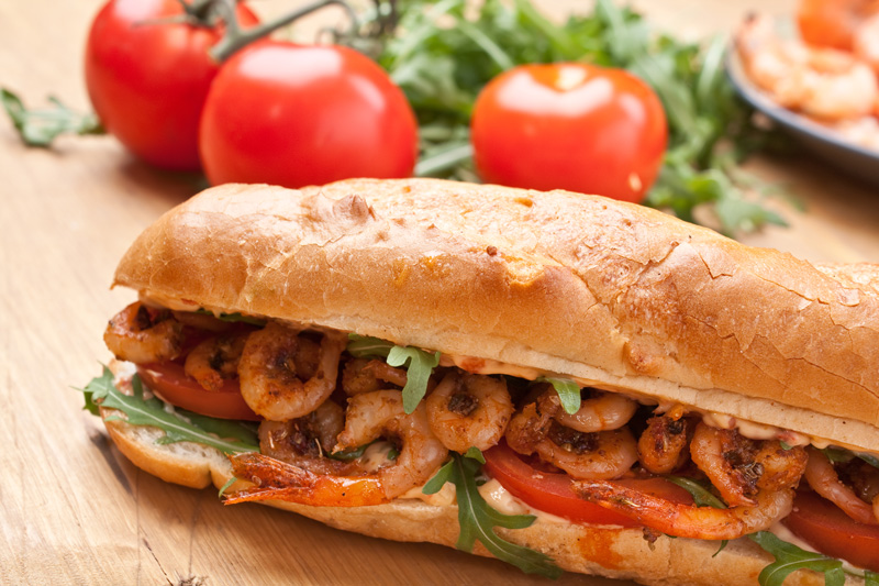 For seafood lovers, the shrimp po'boy, a long roll stuffed with fried shrimp and remoulade sauce, a is a local favourite and a must-try.
