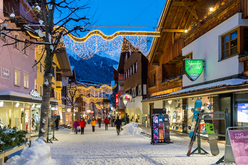 An Alpine town by night bring some romance and picture postcard scenery to your winter holiday.
