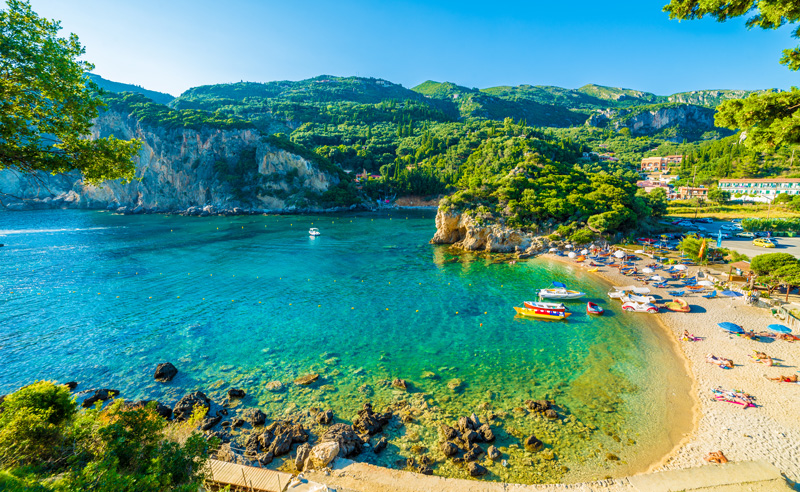 Paleokastritsa in Corfu is a perfect representation of the timeless beauty of Greece and its islands; that you can also relish the most delicious of traditional Greek cuisine while drinking in views such as this is a holiday bonus!