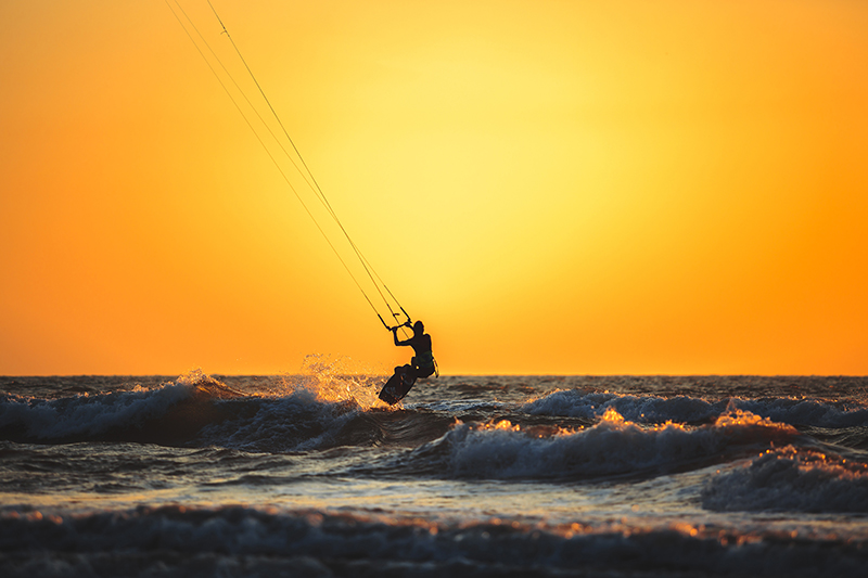 Kite boarding is just one of many water sports to be enjoyed in the warm and balmy waters of the Arabian Sea which laps Goa's beachy shores.