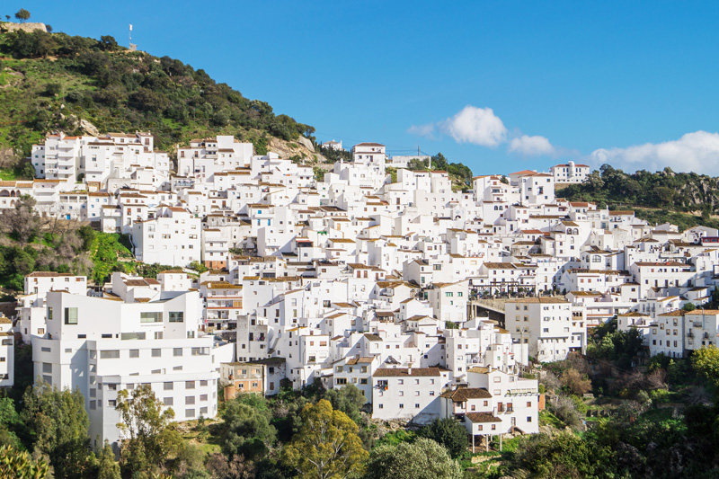 Close to the elegant resort of Estepona, the quaint village of Casares, with its ancient streets of white houses tumbling down the hillside, is a worthwhile stop along the way.