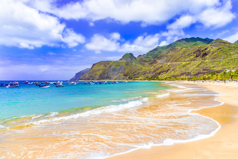 Madeira is a destination filled with interesting towns, lush greenery, and glorious sandy beaches. For many of us, a beach is a necessity on holiday, and thankfully, Madeira delivers.