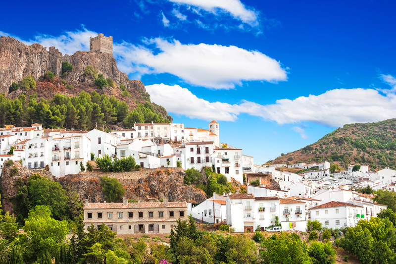 Zahara de la Sierra, a fortified hill town and one of the finest of the pueblos blancos. Perched on the north side of the Pass of the Doves, this ancient town is overlooked by the tower of its 12th century Moorish castle.