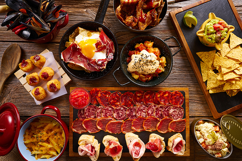 You can't visit Spain without trying some of the local Tapas dishes. Tapas is a good way to try multiple dishes, without spending a fortune!