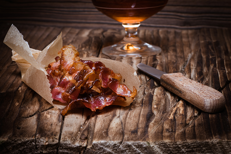 The smoky qualities of both bacon and whisky make them the perfect pairing to compliment one another.